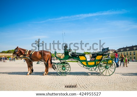 VIENNA, AUSTRIA - APRIL 23, 2016: Old-fashioned fiacre in Schonbrunn Palace - stock photo