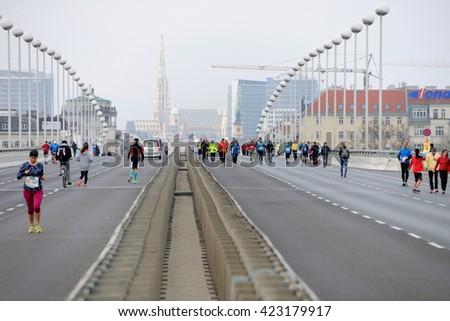 VIENNA, AUSTRIA - APRIL 10, 2016: Runners go over Reichsbrucke to the start of the Vienna City Marathon , April 10, 2016 in Vienna, Austria. - stock photo