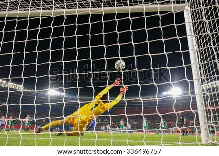 VIENNA, AUSTRIA - AUGUST 28, 2014: Jan Novota (#1 Rapid) fails to catch the ball in an UEFA Europa League qualifying game. - stock photo