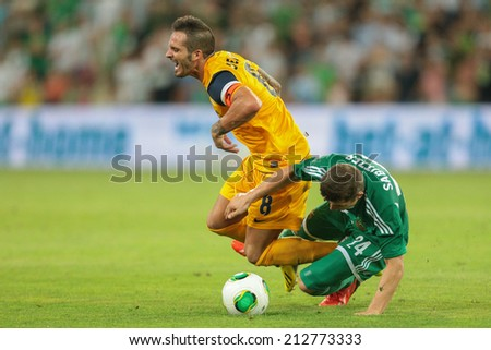 VIENNA, AUSTRIA - AUGUST 8 Marcel Sabitzer (#24 Rapid) and Usero (#8 Asteras) fight for the ball at a UEFA Europa League game on August 8, 2013 in Vienna, Austria. - stock photo