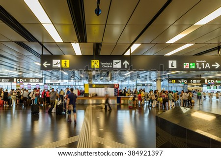 VIENNA, AUSTRIA - AUGUST 12, 2015: People Walking Inside The Terminal Of Vienna International Airport (built in 1938), Country's Biggest Airport That Serves As The Hub For Austrian Airlines and Niki. - stock photo