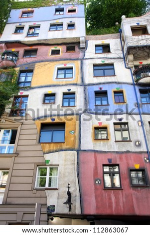 VIENNA, AUSTRIA - AUGUST 18: The Hundertwasser House on august 18, 2012 in Vienna. Has become part of Austria's cultural heritage,it's an apartment house.Concept of artist Friedensreich Hundertwasser. - stock photo