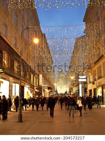 VIENNA, AUSTRIA - DECEMBER 31, 2013: famous Graben street by night on December 31, 2013 in Vienna, Austria. The Graben traces its origin back to the old Roman encampment of Vindobona. - stock photo