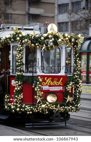 VIENNA, AUSTRIA - DECEMBER 11: Specially decorated Christmas tram ride through the streets of Vienna on the joy of children, December 11,2011 in Vienna, Austria. - stock photo
