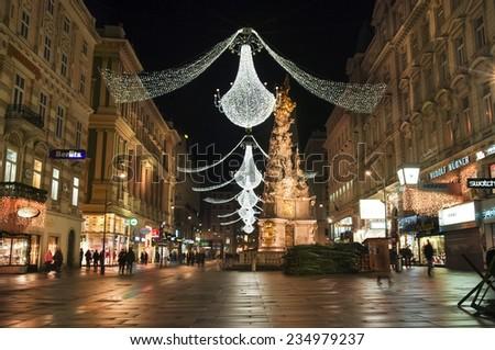 VIENNA, AUSTRIA - December 11, 2009: Vienna - famous Graben street at night with Christmas chandeliers in Vienna, Austria. on December 11, 2009 - stock photo