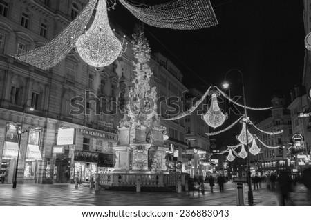 VIENNA, AUSTRIA - December 11, 2009: Vienna - famous Graben street at night with Christmas chandeliers in Vienna, Austria. on December 11, 2009. - stock photo