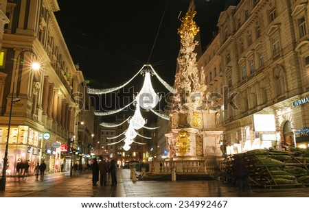 VIENNA, AUSTRIA - December 11, 2009: Vienna - tourists on famous Graben street at night with Christmas chandeliers in Vienna, Austria. on December 11, 2009 - stock photo