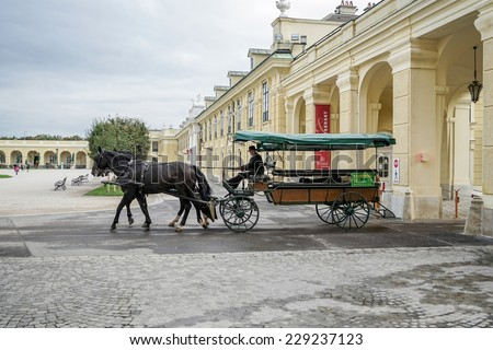 VIENNA, AUSTRIA/EUROPE - SEPTEMBER 23 : Horse and carriage at the Schonbrunn Palace in Vienna Austria on September 23, 2014. Unidentified people. - stock photo