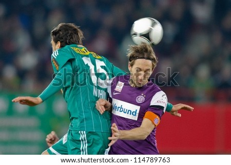 VIENNA, AUSTRIA - FEBRUARY 18 Atdhe Nuhiu (#15 Rapid) and Manuel Ortlechner (#14 Austria) fight for the ball on February 18, 2012 in Vienna, Austria. The game between Rapid and Austria ends 0:0. - stock photo