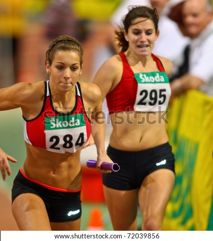 VIENNA, AUSTRIA - FEBRUARY 19: Indoor track and field championship. Sophie Enzinger (#284, Austria) places fourth in the women's 4x200 relay event on February 19, 2011 in Vienna, Austria. - stock photo