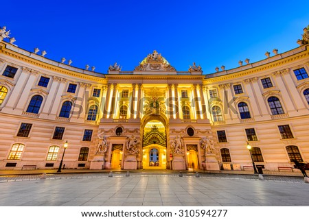 Vienna, Austria. Hofburg Palace seen from Michaelerplatz, wide-angle view at dusk, Habsburg Empire landmark in Vienn - stock photo