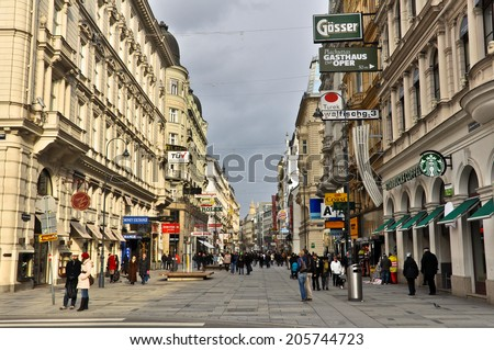 VIENNA, AUSTRIA - JANUARY 12: Main pedestrian street in central Vienna on January 12, 2013, in Vienna, Austria. The pedestrian dominated centre of Vienna is packed with tourists and great shopping. - stock photo