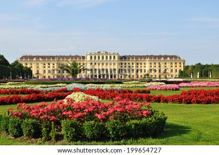 VIENNA, AUSTRIA - JULY 6, 2011: Beautiful gardens and architecture at Schonbrunn Palace, major historic and cultural landmark in the Viennese capital city.  - stock photo