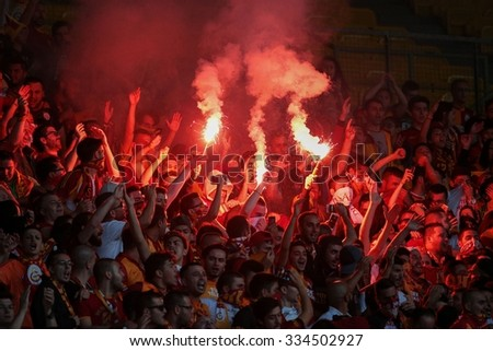 VIENNA, AUSTRIA - JULY 27, 2014: Fans of Galatasaray Istanbul cheer on their team during a friendly game against SK Rapid Vienna. - stock photo