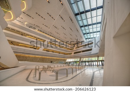 VIENNA, AUSTRIA - JULY 18, 2014: Interior of the new Vienna University of Economics and Business. It is placed near Vienna Prater and designed by famous architect Zaha Hadid. Hdr image. - stock photo