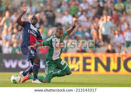 VIENNA, AUSTRIA - JULY 12 Terrence Boyd (#9 Rapid) and Zoumana Camara (#6 Paris) fight for the ball at a friendly soccer game on July 12, 2013 in Vienna, Austria. - stock photo