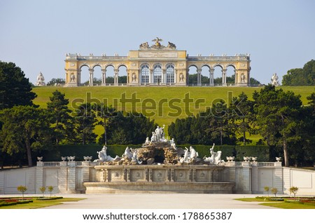VIENNA, AUSTRIA - JULY 26,2013: View on Gloriette and Neptune fountain in Schonbrunn Palace. Schonbrunn main summer residence of Austrian emperors of a dynasty Gabsburg  - stock photo