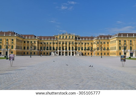 VIENNA, AUSTRIA - 23 JUN 2013: Schonbrunn Palace with gardens. The former imperial summer residence is a UNESCO World Heritage site and Austria's most-visited tourist attraction - stock photo