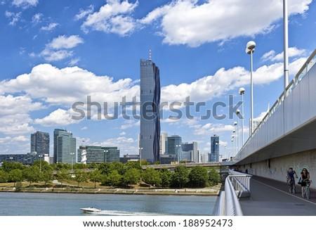 VIENNA, AUSTRIA - JUNE 24: Danube City Vienna with Reichsbruecke (Empire Bridge) and the brand new DC-Tower on June 24, 2012 in Vienna, Austria. The DC-Tower is the tallest skyscraper in Austria. - stock photo