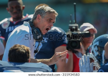 VIENNA, AUSTRIA - JUNE 7, 2014: Head Coach Larry Legault (France) speaks to his team during the game against Finland. - stock photo