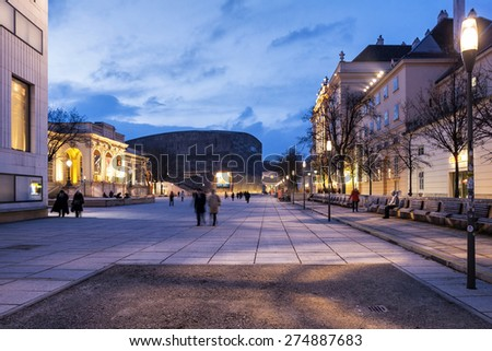 VIENNA, AUSTRIA - MARCH 4: Many people enjoy a walk in the dusk at the Museumsquartier on March 4, 2009 in Vienna, Austria. It is the eighth largest cultural area in the world. - stock photo