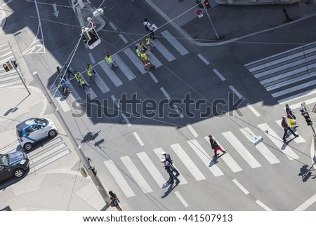 VIENNA, AUSTRIA - MAY 29, 2012: Some people crossing the Gumpendorfer street in the 6th district of Vienna at a sunny da. - stock photo