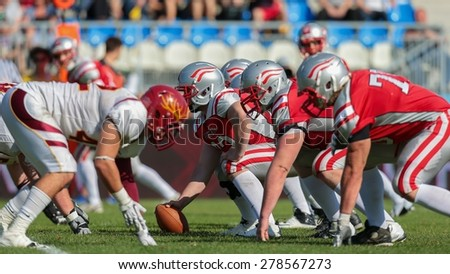 VIENNA, AUSTRIA - MAY 26, 2014: Team Austria face the Claremont McKenna Stags at the line of scrimmage. - stock photo