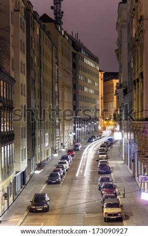 VIENNA, AUSTRIA - NOV 25: Vienna - famous narrow street in first district at night with cars parking  and lights of windows and houses on November 25, 2009 in Vienna, Austria. - stock photo