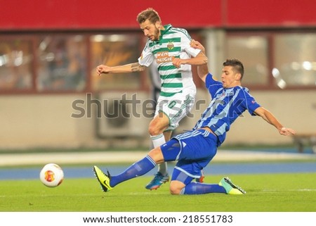 VIENNA, AUSTRIA - OCTOBER 3 Aleksandar Dragovic (#6 Kiew) and Guido Burgstaller (#30 Rapid) fight for the ball at a UEFA Europa League game on OCTOBER 3, 2013 in Vienna, Austria. - stock photo