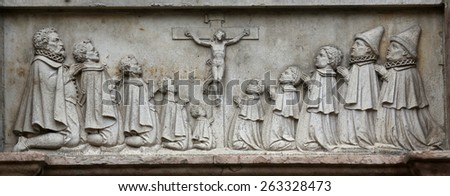 VIENNA, AUSTRIA - OCTOBER 10: An old crucifixion relief sculpture outside St. Stephen's Cathedral in Vienna, Austria on October 10, 2014 - stock photo