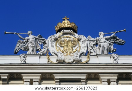 VIENNA, AUSTRIA - OCTOBER 10, 2014: Architectural artistic decorations on Hofburg palace, Vienna; Austria. Hofburg was residence of Habsburg dynasty, rulers of Austro-Hungarian Empire. Vienna, Austria - stock photo