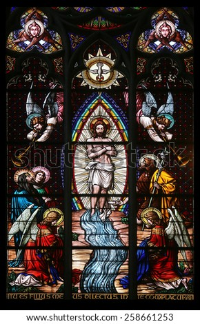 VIENNA, AUSTRIA - OCTOBER 11: Baptism of the Christ, Stained glass in Votiv Kirche (The Votive Church). It is a neo-Gothic church in Vienna, Austria on October 11, 2014 - stock photo