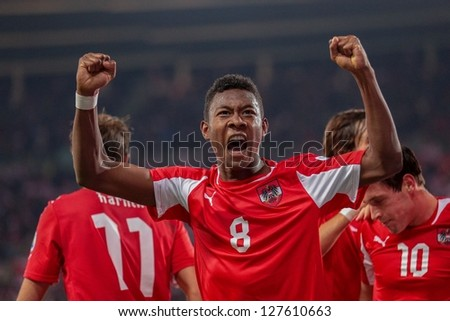 VIENNA,  AUSTRIA - OCTOBER 16: David Alaba (#8 Austria) celebrates after a goal during the WC qualifier soccer game on October 16, 2012 in Vienna, Austria. - stock photo