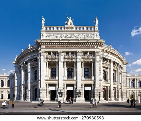 VIENNA, AUSTRIA - OCTOBER 8, 2010: Historic Burgtheater (Court Theatre) at the famous Wiener Ringstrasse with some people in front. Its one of the most important German language theatres in the world. - stock photo