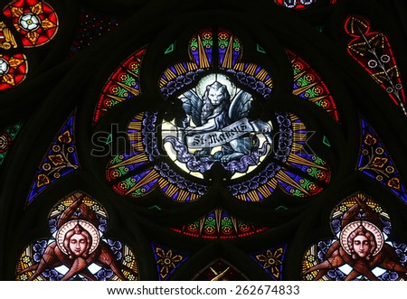 VIENNA, AUSTRIA - OCTOBER 11: Saint Mark the Evangelist, Stained glass in Votiv Kirche (The Votive Church). It is a neo-Gothic church located on the Ringstrabe in Vienna, Austria on October 11, 2014 - stock photo