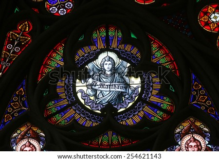 VIENNA, AUSTRIA - OCTOBER 11: Saint Matthew the Evangelist, Stained glass in Votiv Kirche (The Votive Church). It is a neo-Gothic church in Vienna, Austria on October 11, 2014 - stock photo