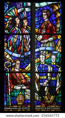 VIENNA, AUSTRIA - OCTOBER 10: Stained glass in Votiv Kirche (The Votive Church). It is a neo-Gothic church in Vienna, Austria on October 10, 2014 - stock photo