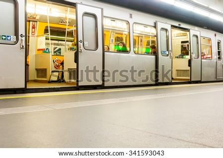 VIENNA, AUSTRIA - OCTOBER 18, 2015:  Subway train and passengers at Karlsplatz station, Vienna, Austria. - stock photo