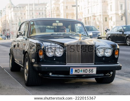 Vienna, Austria, Sep 24, 2014: luxury Rolls Royce Silver Shadow II car (released circa 1978 in England, UK) parked on Schwarzenbergplatz with an unidentified driver inside. - stock photo