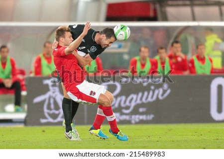 VIENNA, AUSTRIA - SEPTEMBER 10 Andreas Weimann (#9 Austria) and ohn O'Shea (#4 Ireland) fight for the ball at a World Cup Qualifying game on September 10, 2013 in Vienna, Austria. - stock photo