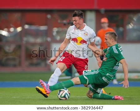 VIENNA, AUSTRIA - SEPTEMBER 28, 2014: Christopher Dibon (#17 Rapid) and Nils Quaschner (#42 Salzburg) fight for the ball in an Austrian soccer league game. - stock photo