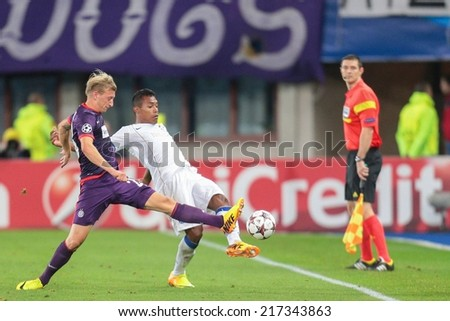 VIENNA, AUSTRIA - SEPTEMBER 18 Daniel Royer (#28 Austria) and Josu���© (#8 Porto) fight for the ball at a UEFA Champions League game on September 18, 2013 in Vienna, Austria. - stock photo