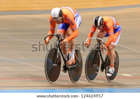 VIENNA,  AUSTRIA - SEPTEMBER 27  Hugo Haag and Jeffrey Hoogland (Netherlands) compete in the men's team sprint event of an indoor cycling meeting on September 27, 2012 in Vienna, Austria. - stock photo