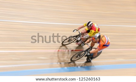 VIENNA,  AUSTRIA - SEPTEMBER 28  Jakub Vyvoda (Czech Repbulic) and Jeffrey Hoogland (Netherlands) compete in the men's keirin event of a cycling meeting on September 28, 2012 in Vienna, Austria. - stock photo