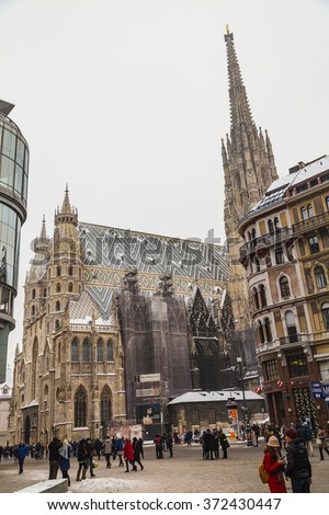 VIENNA, AUSTRIA - 5TH JANUARY 2016: A low view of St. Stephen's Cathedral (Stephansdom) and Stephansplatz in Vienna during the winter. Snow can be seen on the building. People can be seen. - stock photo