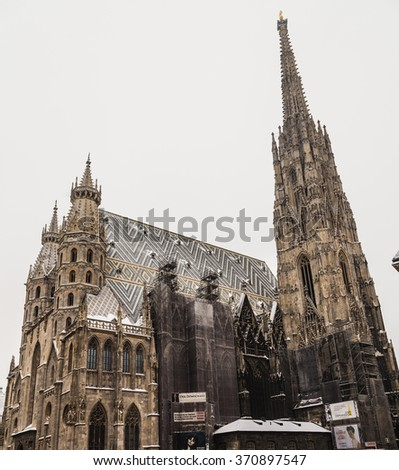 VIENNA, AUSTRIA - 5TH JANUARY 2016: A low view of St. Stephen's Cathedral (Stephansdom) at Stephansplatz in Vienna during the winter. Snow can be seen on the building. - stock photo