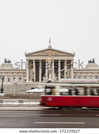 VIENNA, AUSTRIA - 5TH JANUARY 2016: Old trams and traffic outside the Austrian Parliament building in Vienna during the winter months. - stock photo