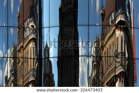 Vienna classic architecture mirrored in the glass of modern building - stock photo