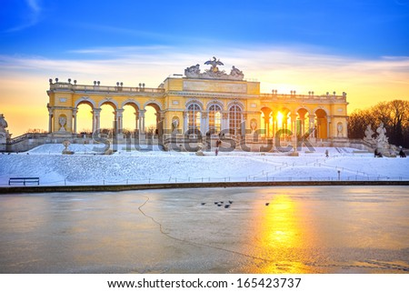 VIENNA - DECEMBER 13 2012: Gloriette in Schonbrunn Palace, Vienna, Austria illuminated by sunset on December 13, 2012. Built in 1775, it was used as a festival hall for emperor Franz Joseph I. - stock photo