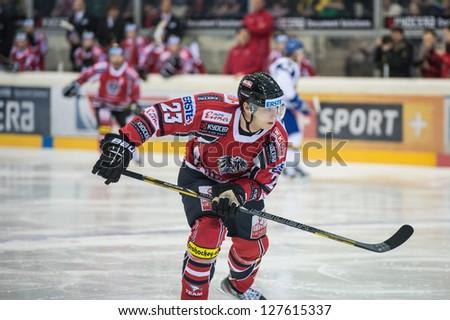 VIENNA - FEB 3: International hockey game between Austria and Kazakhstan. Matthias Iberer skates in the offensive zone on February 3, 2013 at Albert Schultz Halle in Vienna, Austria. - stock photo